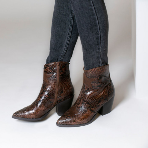 Brown heeled ankle boots with star-shaped cuts