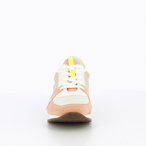 White sneakers with neon yellow detailing