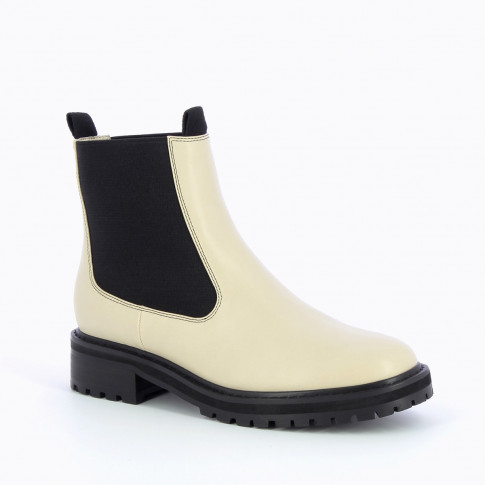 Beige Chelsea boots with serrated sole