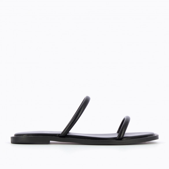 black mules minimalist with rounded straps and padded sole chic woman Vanessa Wu