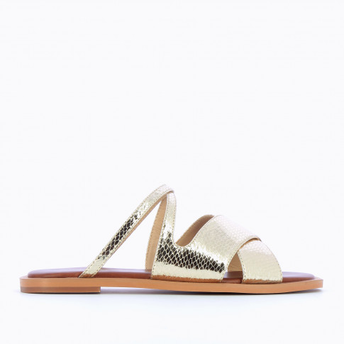 Gold flat mules with crossed straps