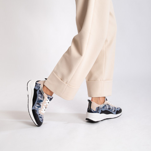 Army blue sneakers with flame cutouts